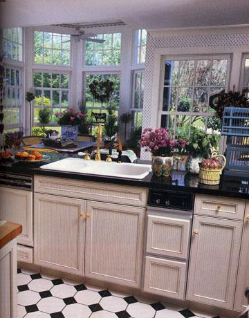 <strong>1990</strong> <br><br> Homeowner fascination with granite pretty much begins. Here, black granite countertops contrast white cabinets.