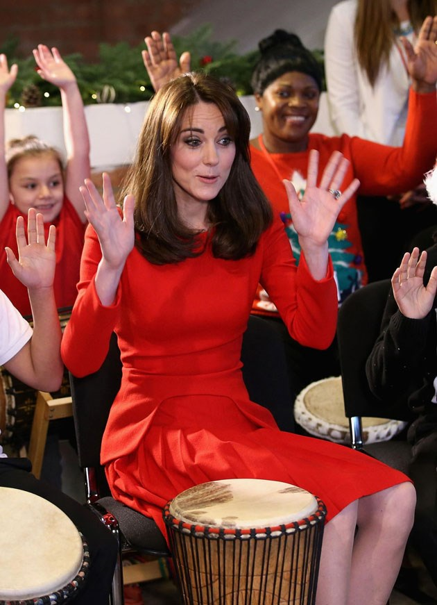 <strong>December 15, 2015</strong> <br><br> For this dress's threepeat, Kate sported her infamous <em>fringe</em>. The bright red suited the occasion: a Christmas party at the Anna Freud Centre Family School. And she did a hand dance with the kids!