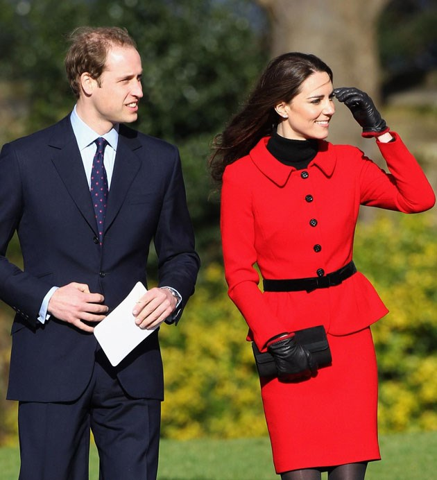 <strong>February 25, 2011</strong> <br><br> Newly engaged, the royal couple returned to their alma mater, St. Andrews in Scotland, for a fundraising event two months before their wedding. Kate wore a red jacket and skirt from Luisa Spagnoli.