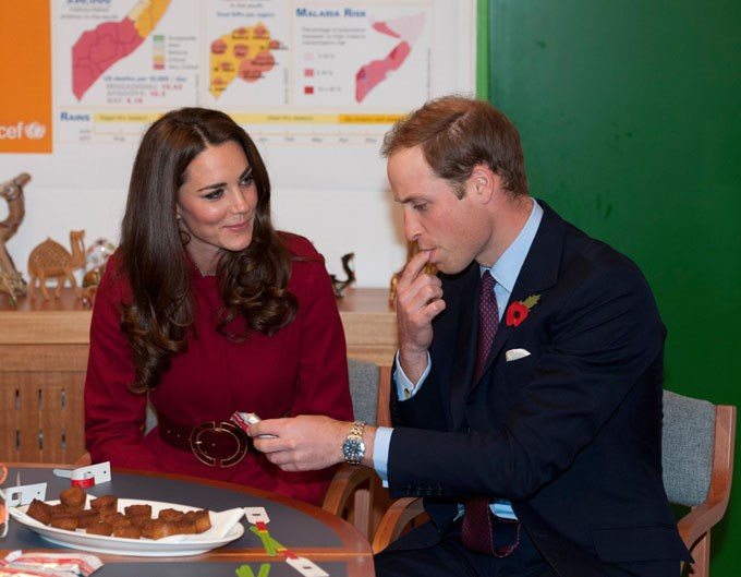 <strong>November 2, 2011</strong> <br><br> While hanging out with the Danish royals, Will and Kate stopped by a UNICEF emergency supply centre and Kate looked on as Will ate some food. She wore a dark red coat from L.K. Bennett, one of her favourite brands and maker of her trusty nude pumps.