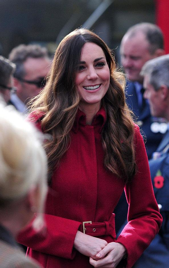 <strong>November 7, 2013</strong> <br><br> Kate put her hair in soft waves (possibly her first and last time wearing this hair) and buckled up her red coat for a meeting with The Royal British Legion's London Poppy Day Appeal at Kensington Palace.
