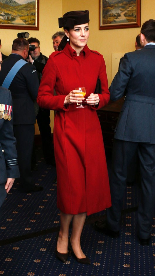 <strong>February 18, 2016</strong> <br><br> Orange juice for the duchess during a reception for the RAF Search and Rescue Force in Anglesey, north Wales. She wore a favourite hat with her L.K. Bennett coat.