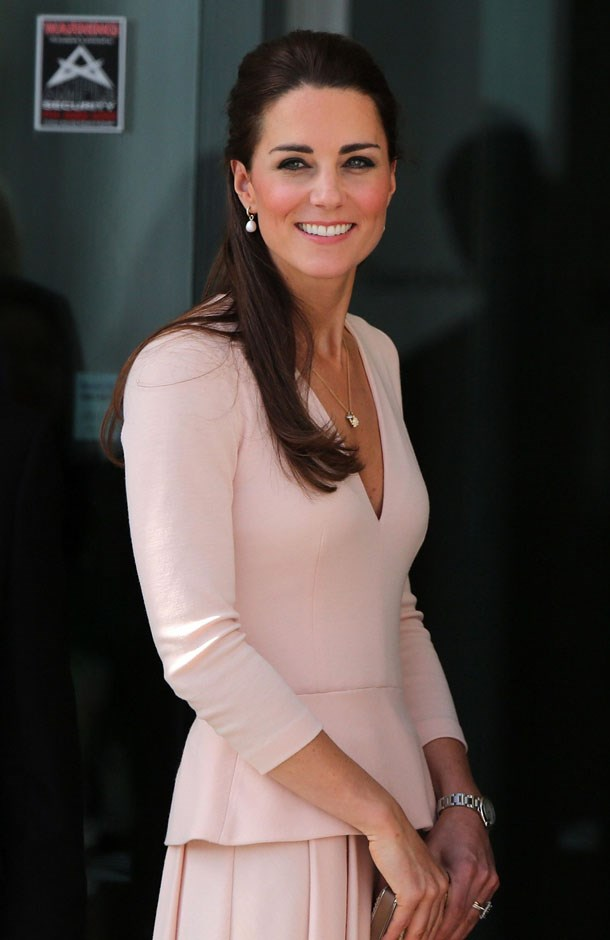 <strong>April 23, 2014</strong> <br><br> Kate wore this pink Alexander McQueen peplum dress for the first time while touring Australia in 2014.