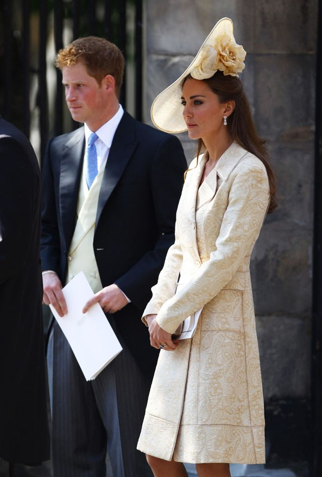 <strong>July 30, 2011</strong> <br><br> For another in-law wedding (the union of Zara Phillips and Mike Tindall) in Scotland, Kate brought back the Day Birger et Mikkelsen, but opted to go with a giant potato chip flower hat.