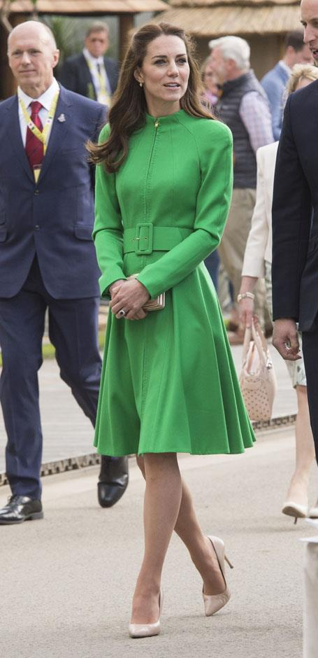 <strong>April 23, 2016</strong> <br><br> Kate stopped to smell the roses at the Chelsea Flower Show in London with other members of the royal family in the green Catherine Walker.