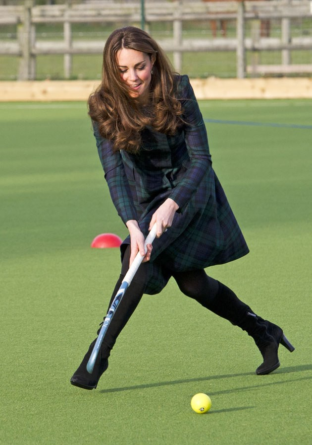 <strong>November 30, 2012</strong> <br><br> Kate went back to her childhood school, St. Andrew's School, in Berkshire, England, wearing a green tartan coat dress by Alexander McQueen. And she played field hockey in heels, because that's how the duchess does.