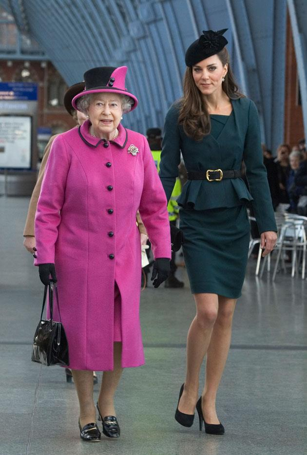 <strong>March 8, 2012</strong> <br><br> Kate joined Queen Elizabeth II for her first official engagement without Will during the Queen's Diamond Jubilee tour. Kate wore dark green separates from L.K. Bennett. Here she is at King's Cross St. Pancras Station in London.