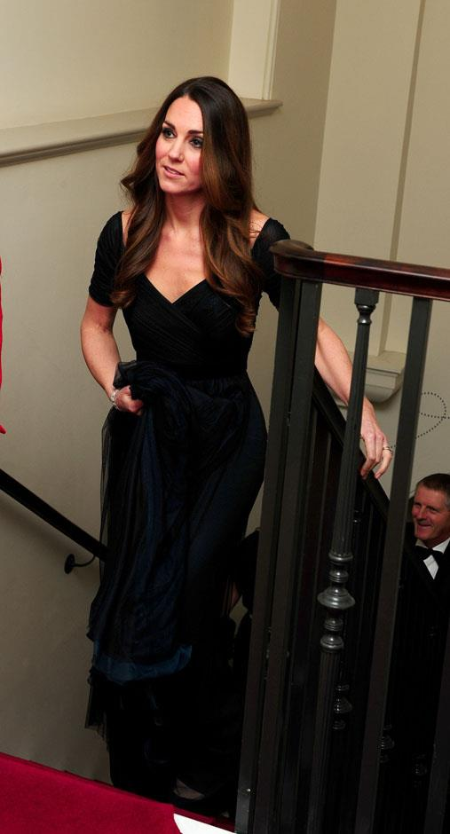 <strong>October 24, 2013</strong> <br><br> Kate held up the long skirt of this dark, blue-green gown by Jenny Packham while at a gala dinner for Action on Addiction hosted by the 100 Women in Hedge Funds in London.