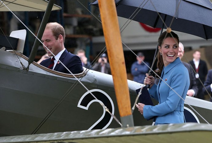 "<strong>April 10, 2014</strong> <br><br> Will is a pilot, right? He went inside a Sopwith Pup at the ""Knights of the Sky"" exhibition in Wellington, New Zealand, while Kate held her own umbrella (!) and observed in a sky blue Alexander McQueen coat."