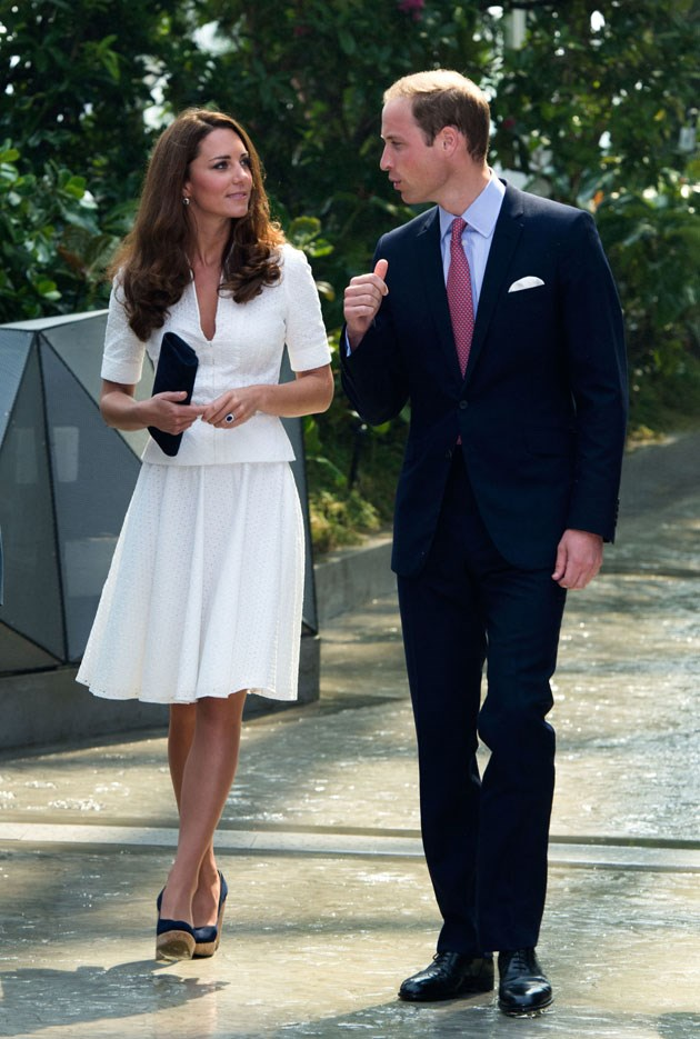 <strong>September 12, 2012</strong> <br><br> Kate first wore this white broderie anglaise dress by Alexander McQueen while in Singapore for a Diamond Jubilee tour. Here, she and Will walked through the Gardens by the Bay.