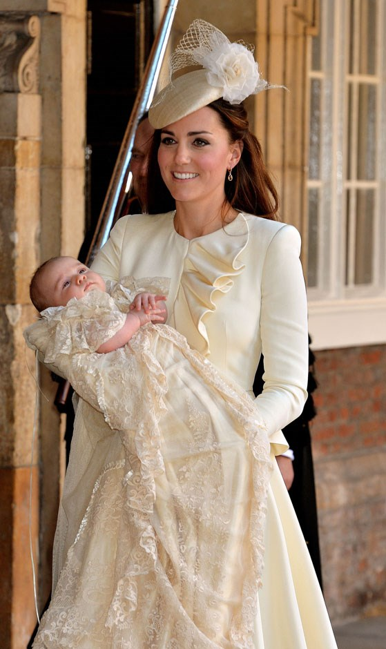 <strong>October 23, 2013</strong> <br><br> For George's christening in at St. James's Palace in London, Kate first wore this cream-coloured Alexander McQueen dress with ruffled detailing down the bodice.