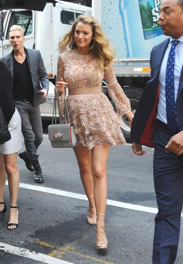 <strong>June 20th, 2016</strong> <br><br> The actress showed off a trim and toned pregnancy body in an embellished Elie Saab mini-dress, grey Louboutin handbag and Stuart Weitzman heels.