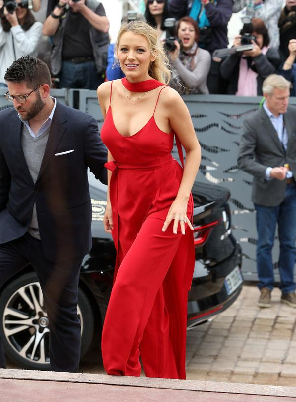 <strong>May 11th, 2016</strong> <br><br> The actress looked striking in a red jumpsuit with waist and neck tie details at the *Cafe Society* photo call.