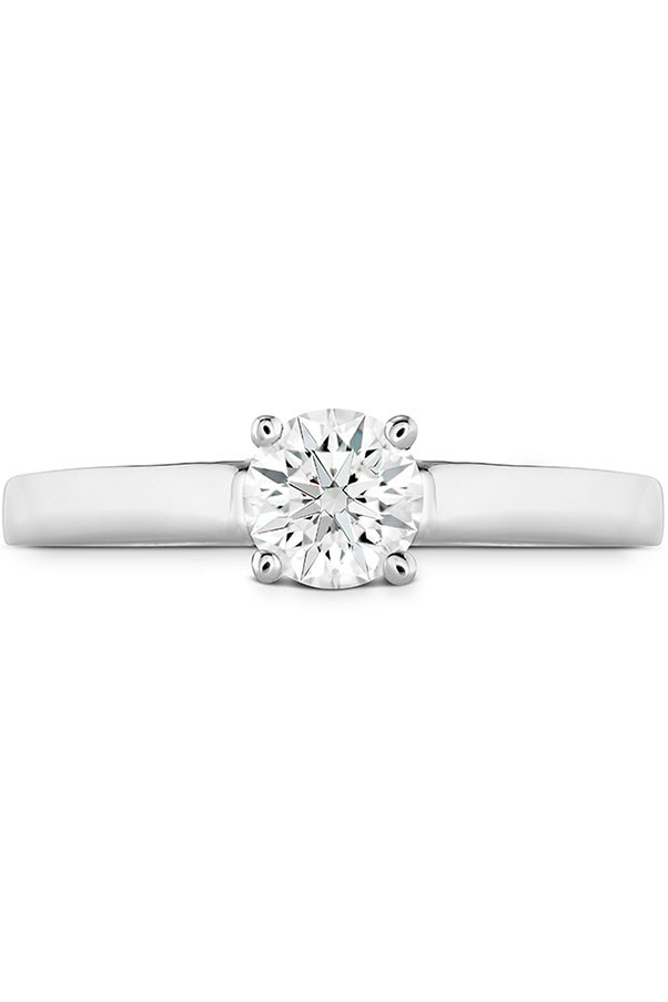 """<strong>Classic Grace</strong> <br><br> <strong>Your ring has: </strong>A round solitaire diamond <br><br> <strong>You are: </strong>A total traditional–and most likely, your ring finger is now sporting something similar to what your grandmother had. """"You're a classic,"""" says Sabatino. """"Just like your ring, you have a timeless sensibility."""" You skip the trends and lean toward things that never go out of style. <br><br> <em>Hearts on Fire Simply Bridal Solitaire Engagement Ring</em>, <a href=""""http://www.heartsonfire.com/shop-jewelry/rings/engagement-rings/simply-bridal-solitaire-engagement-ring.aspx#jcJ0iFKtVgbvRb0m.97"""">heartsonfire.com</a>."""