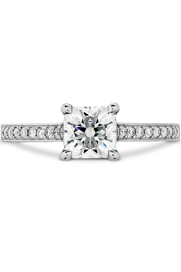 """<strong>Boho Beauty</strong> <strong><br><br> Your ring has:</strong> A pavé infinity band with a square diamond <br><br> <strong>You are:</strong> """"You're relaxed, fun, and free-spirited - a boho bride,"""" Sabatino says; you're all about delicate features, like a pretty, detailed band. Your lifestyle (and personal style) are led by what makes you feel untethered and of-the-moment. <br><br> <em>Hearts on Fire Illustrious Dream Engagement Ring–Diamond Intensive Band</em>, <a href=""""http://www.heartsonfire.com/shop-jewelry/rings/engagement-rings/illustrious-dream-engagment-ring-diamond-intensive-band.aspx#UeGO3x57JCVpjBGk.97"""">heartsonfire.com</a>."""