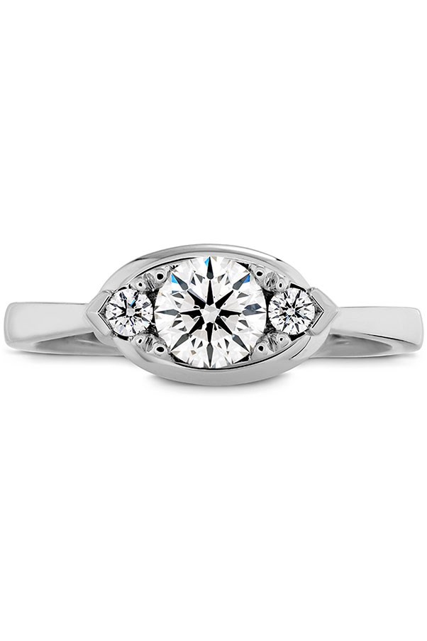 """<strong>Something Special</strong> <br><br> <strong>Your ring has:</strong> An ornate, multi-diamond style <br><br> <strong>You are:</strong> One-of-a-kind. """"You have an appreciation for unique items and one-offs,"""" Sabatino says. """"And you don't mind a little work or digging, because 'the find' is totally worth it."""" A die-hard vintage lover, you like your possessions - and your people - a little eccentric and unconventional. <br><br> <em>Hearts on Fire Optima Regal Engagement Ring</em>, <a href=""""http://www.heartsonfire.com/shop-jewelry/rings/engagement-rings/optima-regal-engagement-ring-horizontal.aspx#84fw6MVE9oT5DHxj.97"""">heartsonfire.com</a>."""