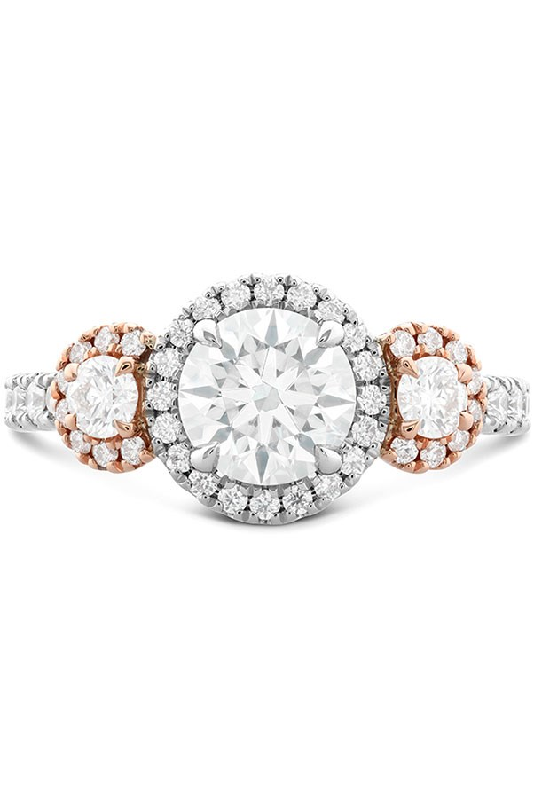"""<strong>Traditional With A Twist</strong> <br><br> <strong>Your ring has:</strong> Three matching cut stones and a mixed-metal setting. <br><br> <strong>You are: </strong>Anything but boring. You go for the classic simplicity of three similar-cut stones, but take it up a notch with a mixed metal setting. """"You can't resist what's in style right now,"""" Sabatino says. Your friends consistently ask you for fashion advice, and your love of what's coming straight off the runways means your closet is extremely well-stocked. <br><br> <em>Integrity Hearts on Fire Three Stone Engagement Ring</em>, <a href=""""http://www.heartsonfire.com/shop-jewelry/rings/engagement-rings/integrity-hof-three-stone-engagement-ring.aspx#XSLj6xj6lMYBGIf9.97"""">heartsonfire.com</a>."""