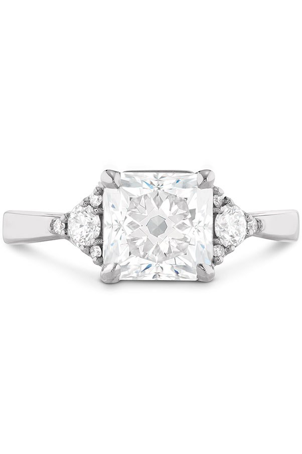 """<strong>A Flare For The Dramatic</strong> <br><br> <strong>Your ring has:</strong> A large square diamond. <br><br> <strong>You are:</strong> Confident and proud. """"Your ring no doubt says, 'I got a rock,'"""" Sabatino says. That big, gorgeous statement piece is a reflection of your glam, Old Hollywood style. You love making an entrance and enjoy being the life of the party. <br><br> <em>Hearts on Fire Triplicity Dream Engagement Ring</em>, <a href=""""http://www.heartsonfire.com/shop-jewelry/rings/engagement-rings/triplicity-dream-engagement-ring.aspx#H2trfV9zjEIc8bTJ.97"""">heartsonfire.com</a>."""