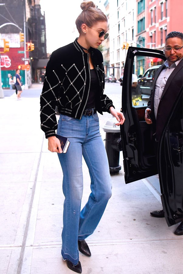 Gigi was spotted in New York in an embellished jacket, flaired denim jeans, black pointed-toe boots and a classic Hermès belt.