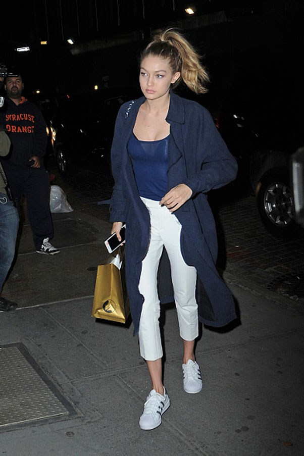 Heading out for dinner in Soho, New York City, Gigi looks candid and oh so sporty-chic in white and navy.