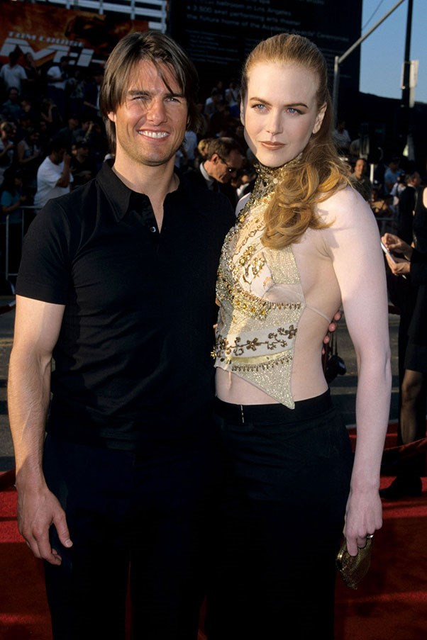 """<strong>Tops that weren't really tops</strong><br><br> There was very little actual sewing involved in the creation of these """"tops."""" They were more like random pieces of fabric draped across the body and tied in place.<br><br> Tom Cruise and Nicole Kidman, 2000"""