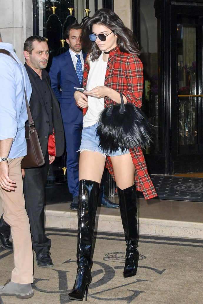 <strong>June 24, 2016</strong> <br><br> Kendall Jenner's steps out in Paris wearing a red plaid flannel, white tee, Re/Done shorts with some killer black over the knee boots.