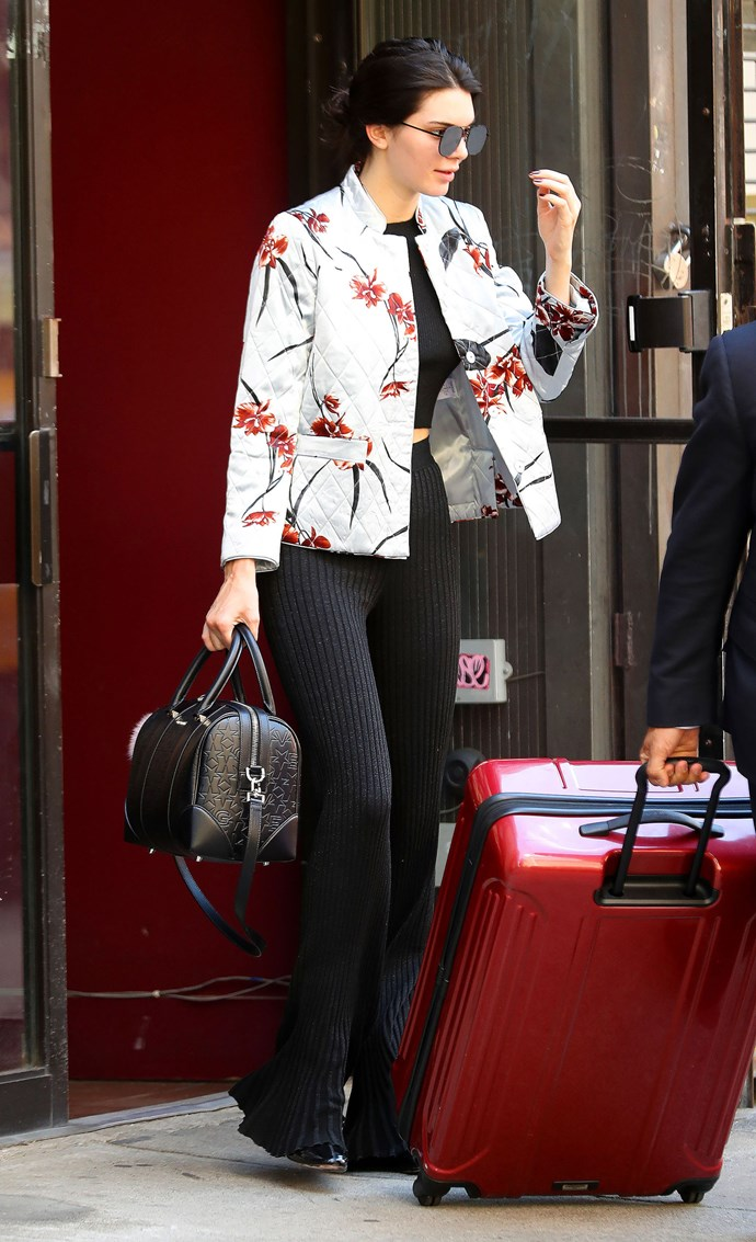 <strong>June 22, 2016</strong> <br><br> On her way to Paris, wearing a Ganni floral jacket, black crop top, pleated wide-leg pants and a leather bowler bag.