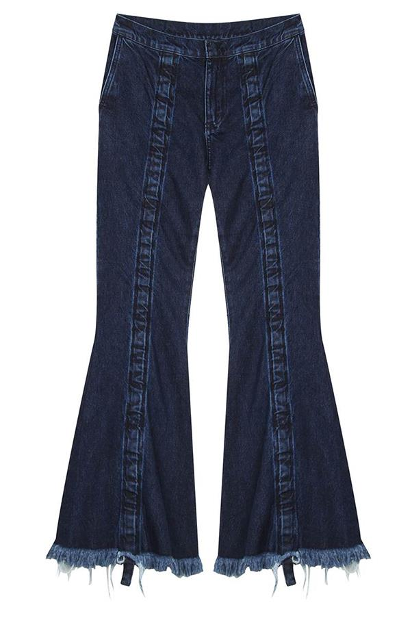 """<strong>Giselle Farhat, <a href=""""https://www.mychameleon.com.au/"""">My Chameleon</a>: </strong> <br><br> """"A flared or wide-leg jean in a deep indigo. The flared jean from Marques' Almeida is a favourite. Raw on the hem and skimming at the ankle for a modern shape. We see it paired with a black blazer and pump, or sweater and loafer."""" <br><br> <strong>The key buy: </strong>Marques' Almeida jeans, $520, from <a href=""""https://www.mychameleon.com.au/ruched-denim-jean-p-4540.html?newstuff=newstuff&typemf=women"""">My Chameleon</a>."""