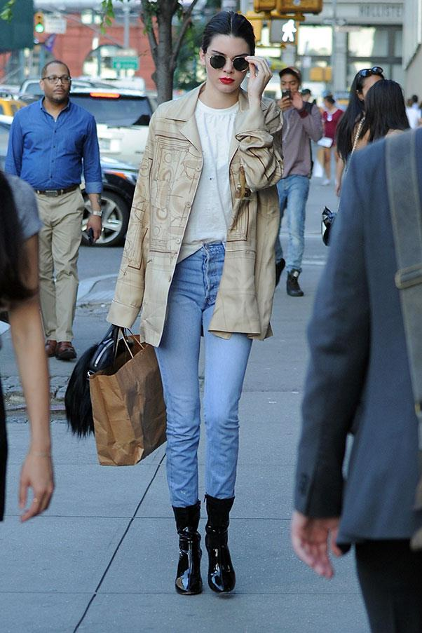 <strong>June 30, 2016</strong><br><br> Kendall paired her classic blue jean/ankle boot combo with a chic beige leather jacket and a red lip while out and about in New York.