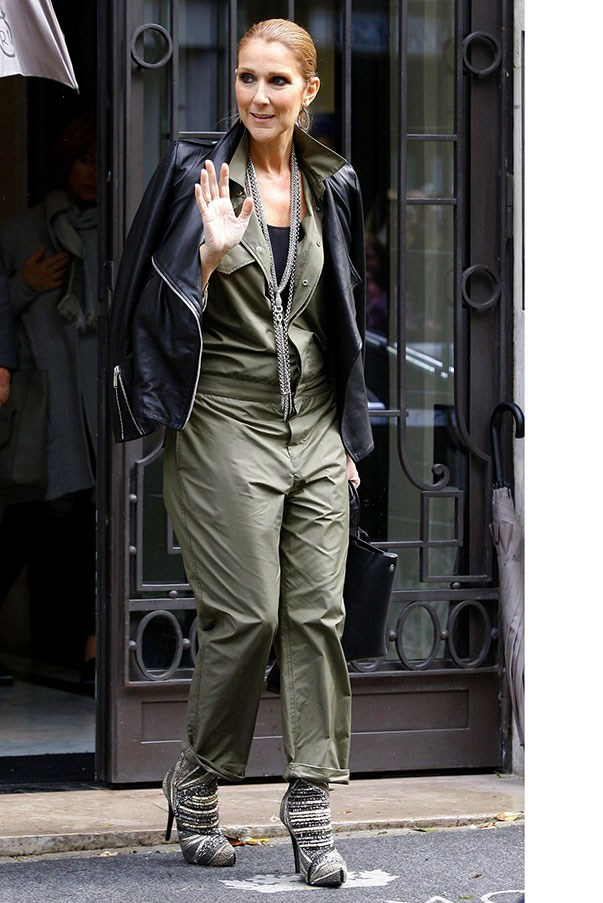 <strong>June 18th, 2016</strong><br><br> In a chic khaki jumpsuit and leather jacket. <br><br> Image: Splash