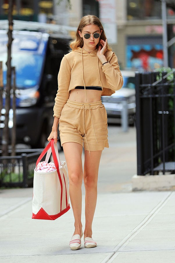Only Gigi Hadid could wear a matching two-piece nude sweatshirt and shorts. She matched it with a canvas tote bag, rounded sunglasses and  Soludos espadrille slip-ons as she walked through NYC.