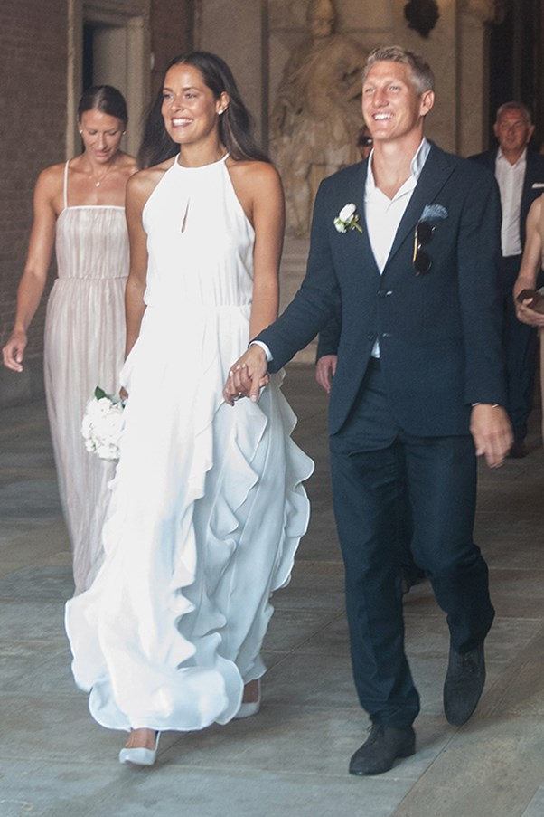Tennis star Ana Ivanovic wore a simple ruffled gown to marry footballer Bastian Schweinsteiger, with the ceremony taking place in Venice.