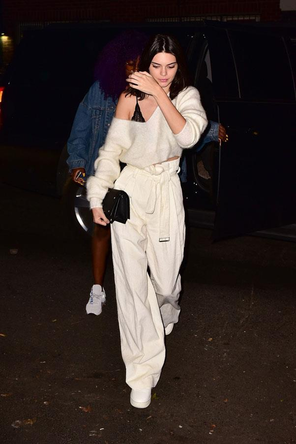 <strong>July 10, 2016</strong><br><br> Kendall donned all white in New York, wearing cream-colored cinched trousers, white sneakers and a matching sweater over a black lace bralette.