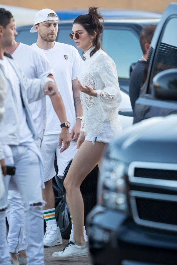 <strong>July 5, 2016</strong> <br><br> Jenner goes all white for Independence Day, wearing a lace Anna Sui top, white denim shorts, white sneakers and round glasses.