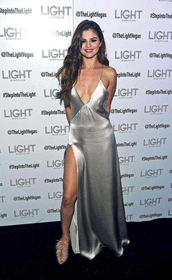 <strong>May 6, 2016</strong> <br><br> Selena kicked off her Revival tour in Las Vegas wearing a silver Galvan slipdress and feathery Manolo Blahnik heels.