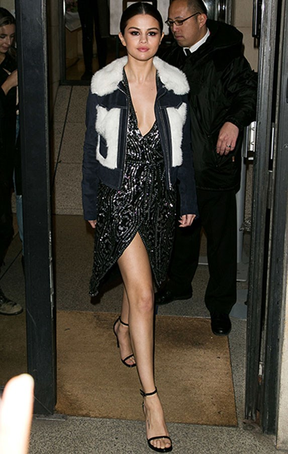 <strong>March 10, 2016</strong> <br><br> Selena stepped out in a thigh cut sequined gown in Paris, underneath a  suede jacket with fur touches by Rodarte & Other Stories.