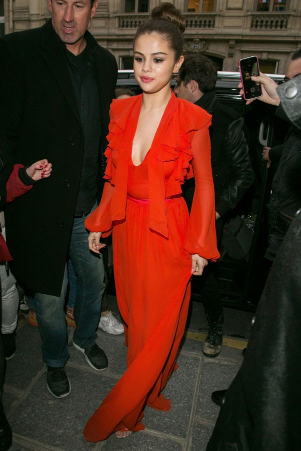<strong>March 10, 2016</strong> <br><br> Selena shone in a bright red ruffled Giambattista Valli silk gown.