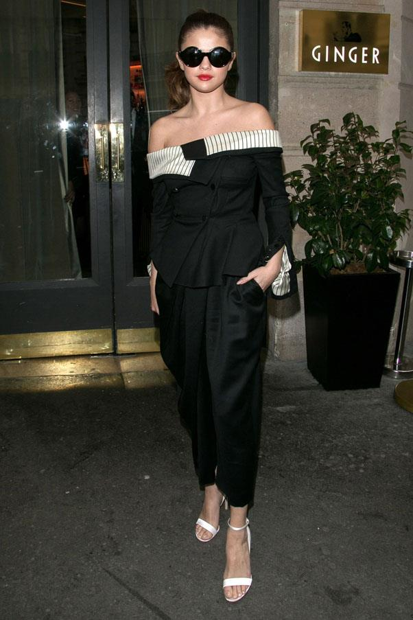 <strong>March 10, 2016</strong> <br><br> Gomez looked elegant in a Monse off-the-shoulder jumpsuit, oversized sunnies and red lips.