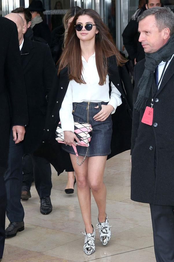 <strong>March 8, 2016</strong> <br><br> Selena wore the it-girl's favourite V lace-up top with a denim mini-skirt and thigh-high boots during Paris Fashion Week.
