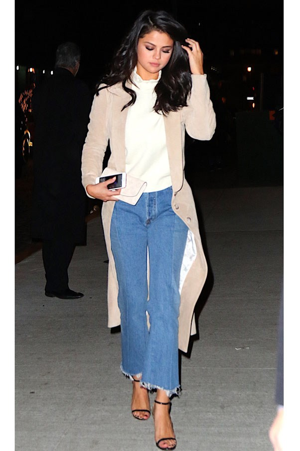 <strong>January 21, 2016</strong> <br><br> Selena stepped out from Nobu in NYC sporting a Wes Gordon suede camel coat draped over an off-white turtleneck and frayed kick flares.