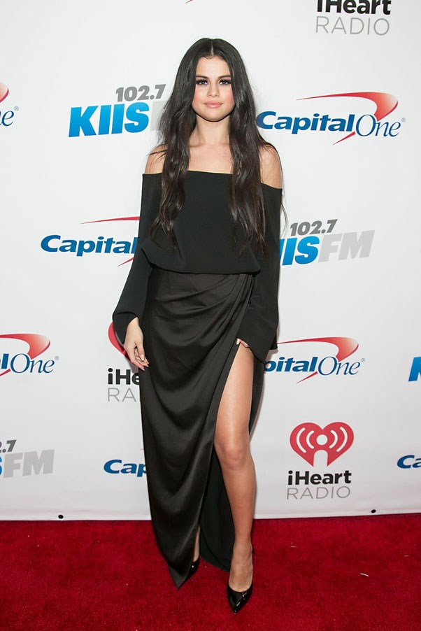 <strong>December 4, 2015</strong> <br><br> Selena wore a Camilla and Marc bell-sleeve top and slit skirt for the Jingle Ball 2015 in Los Angeles.