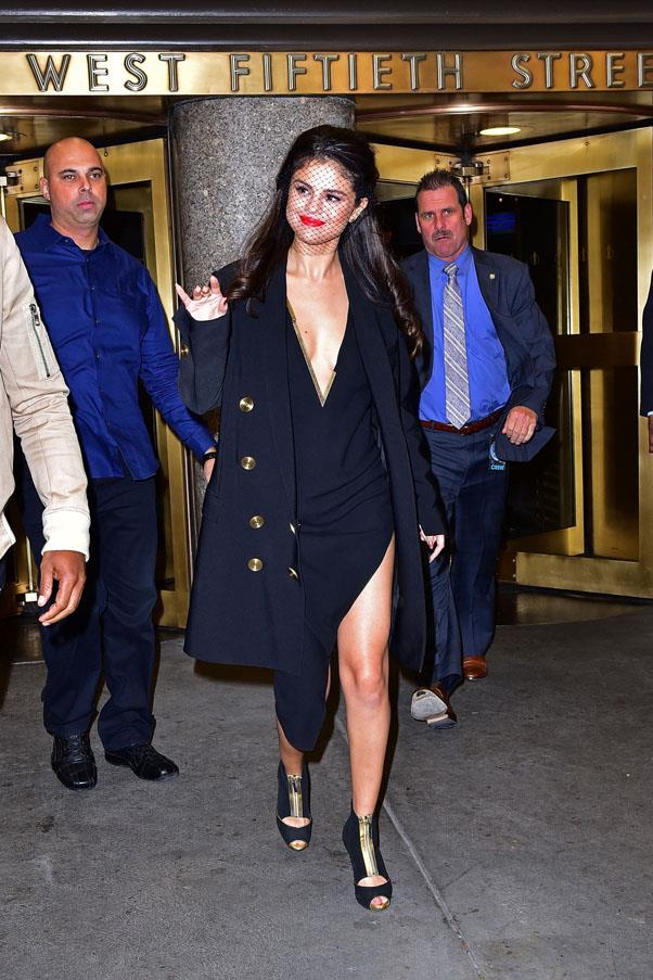 <strong>October 14, 2015</strong> <br><br> Gomez looked classically chic in a black veil and a plunging Anthony Vaccarello dress in New York.