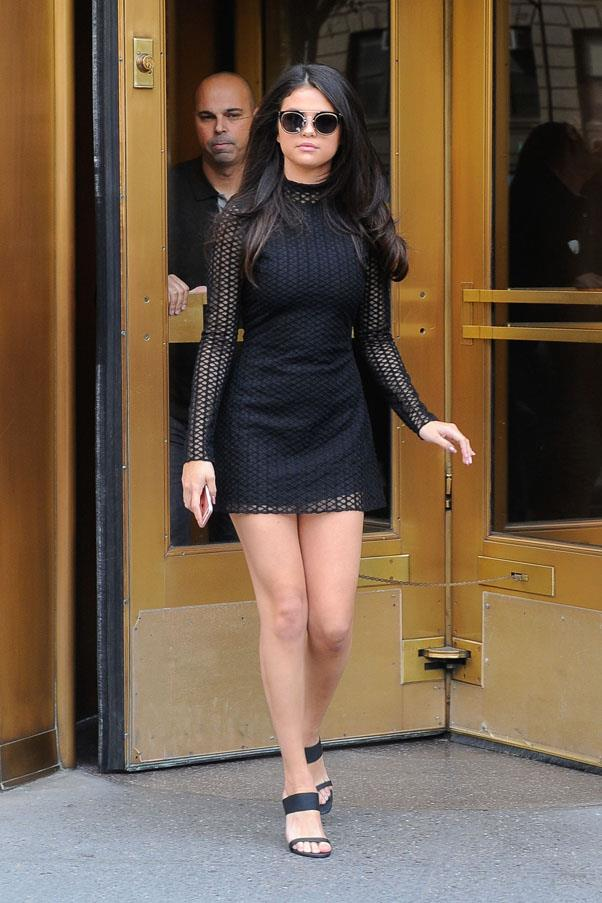 <strong>October 13, 2015</strong> <br><br> She <em>loves</em> these Jenni Kayne mules. Selena paired the look with a David Koma macrame dress.