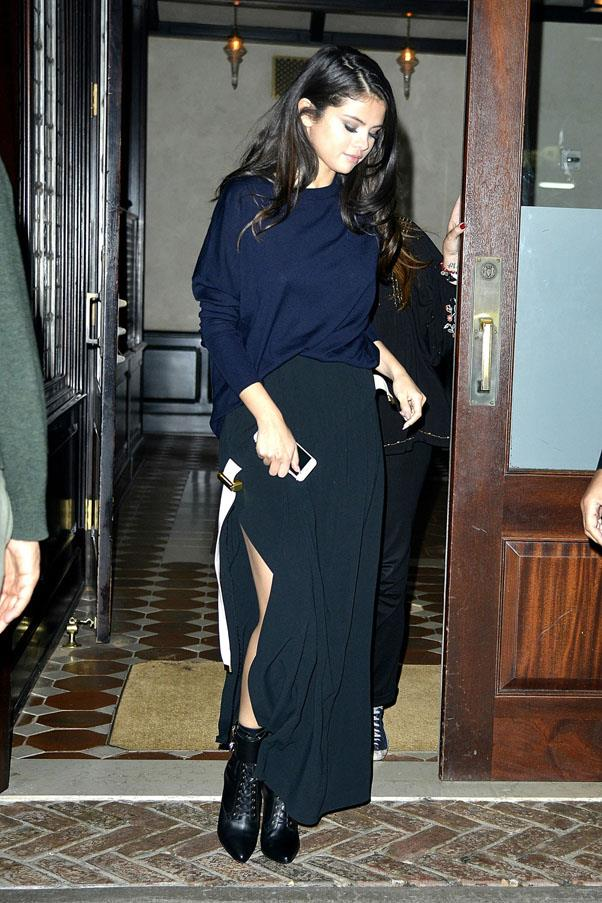 <strong>October 12, 2015</strong> <br><br> Selena stepped up her shoe-game in lace-up booties, matched with a navy slouchy sweater and high slit skirt in New York.