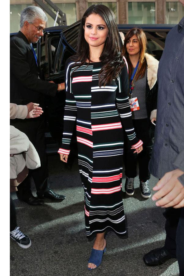 <strong>October 12, 2015</strong> <br><br> Selena opted for a bright number wearing a striped Kenzo dress and royal blue Trademark mules.