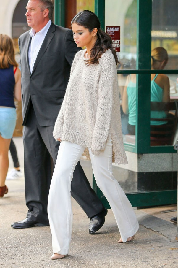 <strong>September 11, 2015</strong> <br><br> She went all-white in New York, wearing an oatmeal-colored Raquel Allegra sweater and white LOVER pants.