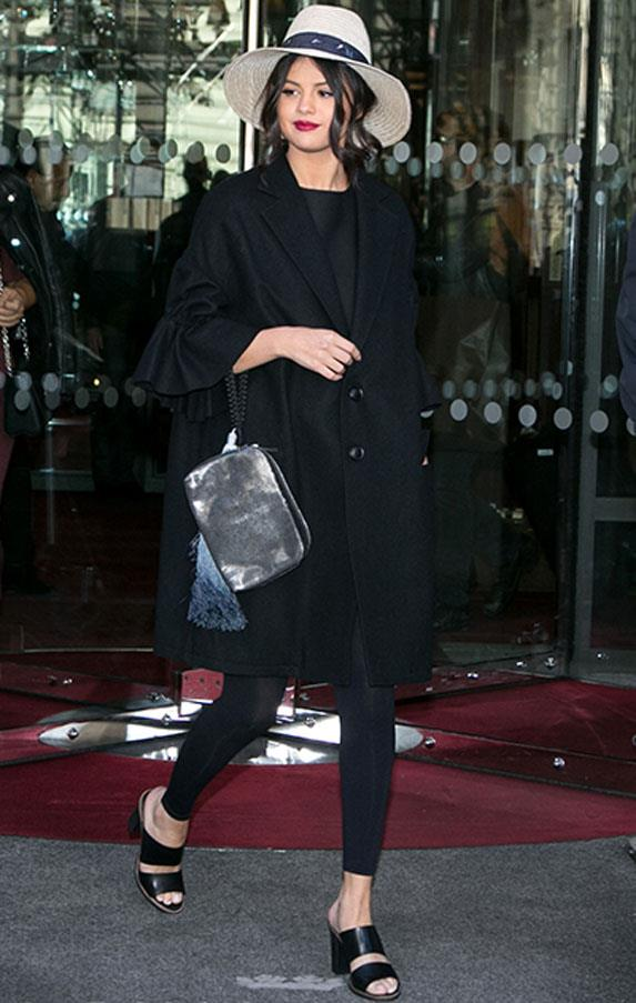 <strong>September 28, 2015</strong> <br><br> Selena looked relaxed in a Yohji Yamamoto oversized ruffle sleeved cotton coat and The Row clutch.