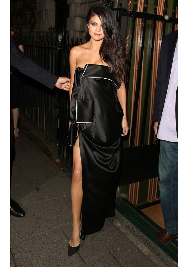 <strong>September 24, 2015</strong> <br><br> Selena stepped out in London wearing a Monse dress.