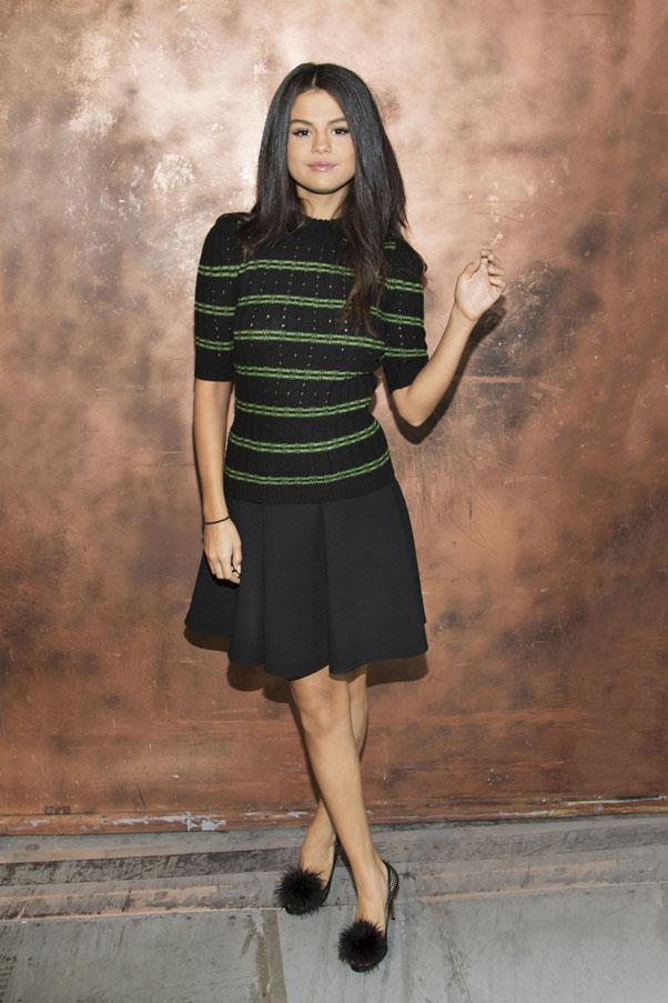 <strong>September 18, 2015</strong> <br><br> Selena posed for some portraits wearing head-to-toe Miu Miu.