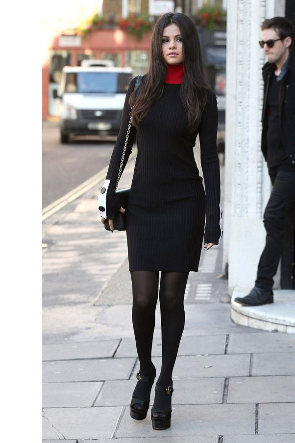 <strong>September 23, 2015</strong> <br><br> The start of a good clothes day for Selena, stepping out in an Edun ribbed turtleneck dress.